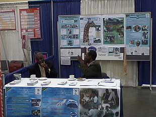 Provost Tumaini University Prof. E. Kessy and Mr. E. Mayo at TATCOT booth