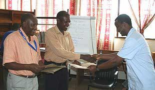 Mr. A. Ndosi Course Coordinator and Mr. L. Mtalo Academic Officer, presenting certificates